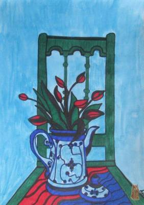 red tulips on the green chair